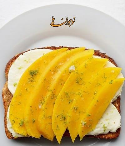 نان تست + پنیر + انبه + رنده پوست لیمو ترش غذای سالم