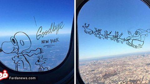 هنرنمایی یک مسافر روی شیشه هواپیما!